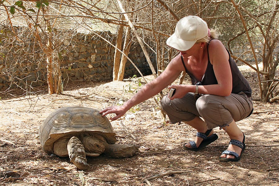 Louise and an giant tortoise, Bandia Wildlife Reserve, Senegal