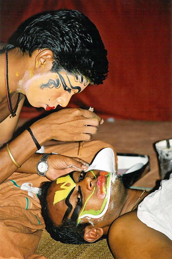 Kathakali dancer applying makeup