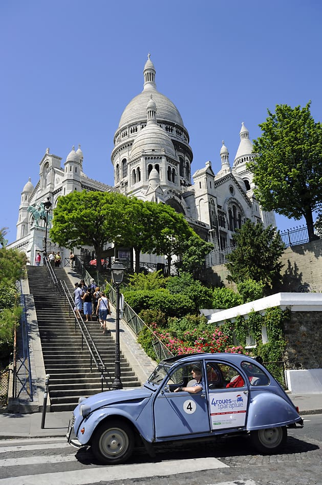 The moment I reached the top of the stairs and caught my first glimpse of the Sacré-Coeur just as a 2 CV, the iconic French car, drove past
