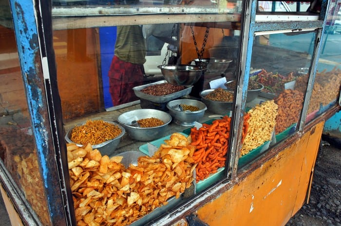 Street food in Sri Lanka | Bright orange spicy crisps