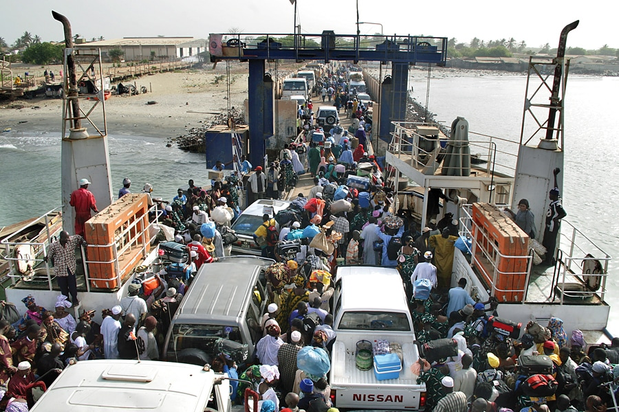 Crowds of people, cars and trucks on the Banjul ferry crossing, The Gambia