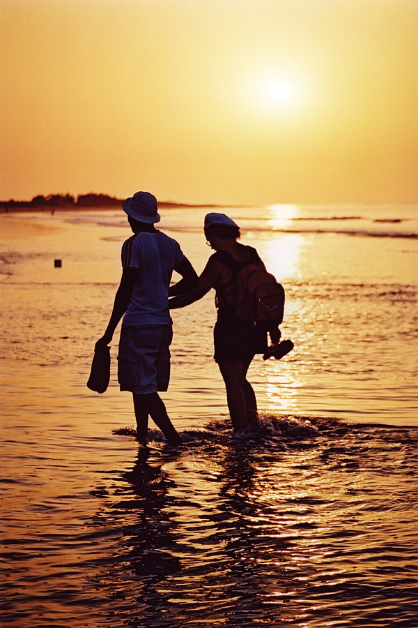 Walk along the beach at sunset in The Gambia