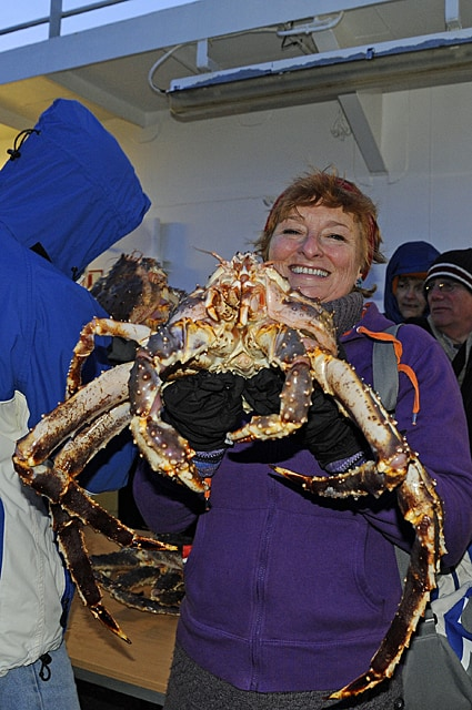 Zoë, The Quirky Traveller with a very large crab!