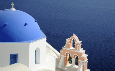 Images of Oia, iconic Santorini, bright, white and blazing in the sizzling sunshine