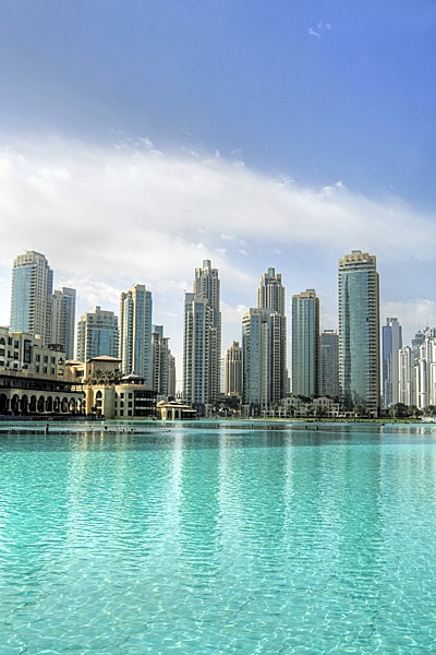 Dubai skyscrapers reflected in a vast shallow pool in the United Arab Emirates