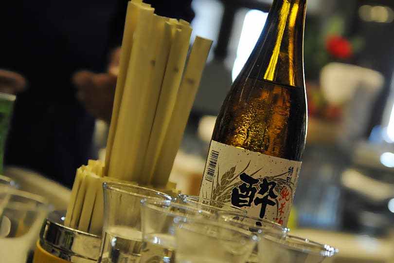 Sake bottle and glasses, taken with my Nikon D700 and my Nikkor 24 to 85mm at its widest focal length