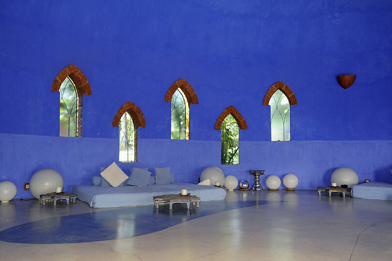 The serene meditation room with chalk blue walls, plenty of natural lights and a calming atmosphere, Nilaya Hermitage, Goa