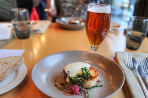 Succulent scallops and a glass of Yardsman Pale Ale, craft beer brewed in Belfast at Deanes of Queens