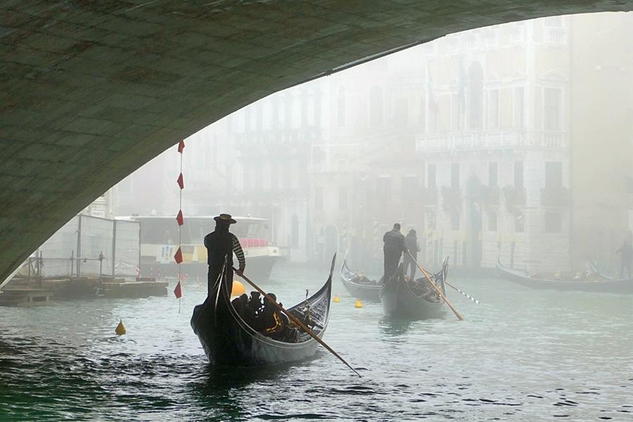 Beneath the bridges in Venice