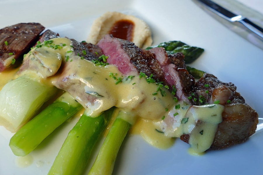 angus beef striploin with a celery root purée, spring vegetables and a Béarnaise sauce