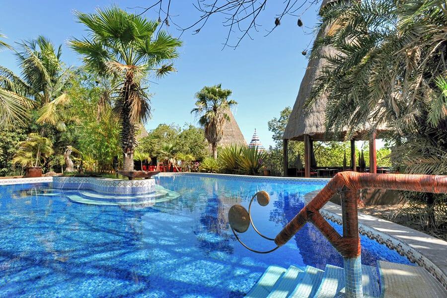 Swimming pool at Mandina Lodges, Makasutu Forest, The Gambia by travel photographer, Kathryn Burrington