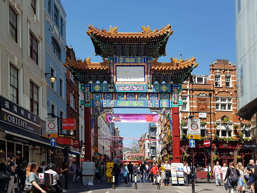 The colourful and ornate Chinese gate that marks the entrance to Chinatown in London, England