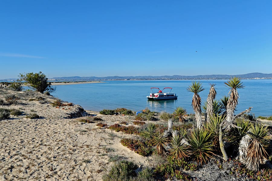 Visiting the flat, sandy island of Ilha Deserta in the Ria Formosa Natural Park, Algarve, Portugal