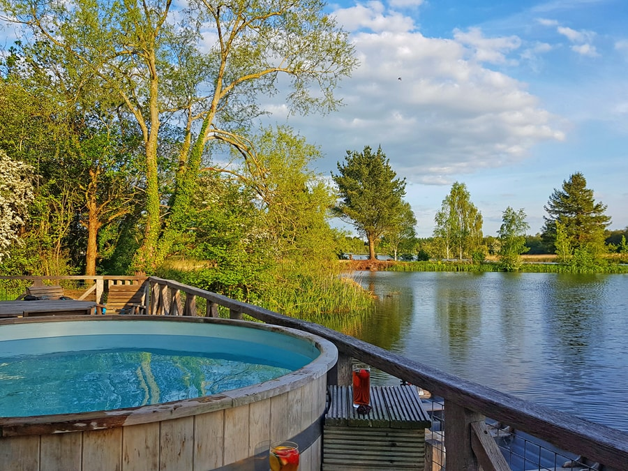 Lodges with hot tubs by a lake in the Cotswolds