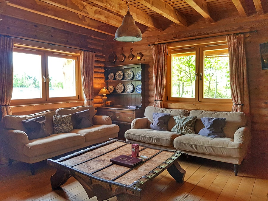 Log House Holdays | Log cabin living area | Lodges with hot tubs