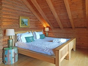 Master bedroom in one of eight lodges with hot tubs in the Cotswolds at Log House holidays