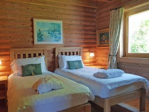 Twin bedroom in one of eight lodges with hot tubs in the Cotswolds at Log House holidays