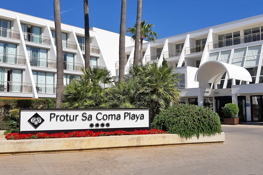 Sign in front of the smart white modern hotel, Protur Sa Coma Playa Hotel in Mallorca