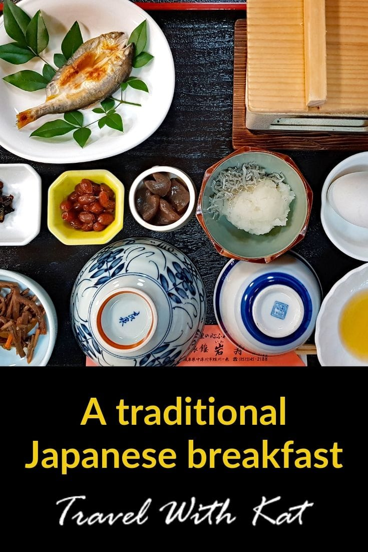 Small dishes tht comprise a traditional Japanese breakfast including grilled fish, rice, fermented soybeans, boiled egg and pickles