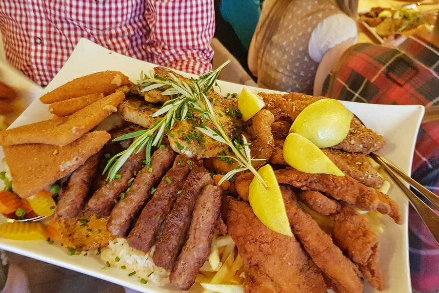 A large plate overflowing with Traditional Styrian cuisine at Glöckl Bräu, Graz, Austria