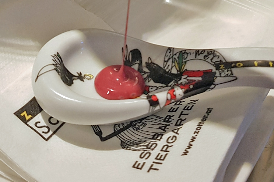 Zotters chocolate tasting in Austria | Raspberry chocolate drizzles onto a tasting spoon