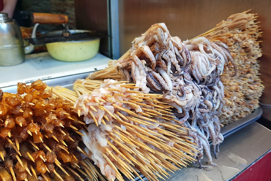 Pile of meat and seafood on skewers in a Changsha street, Hunan,China