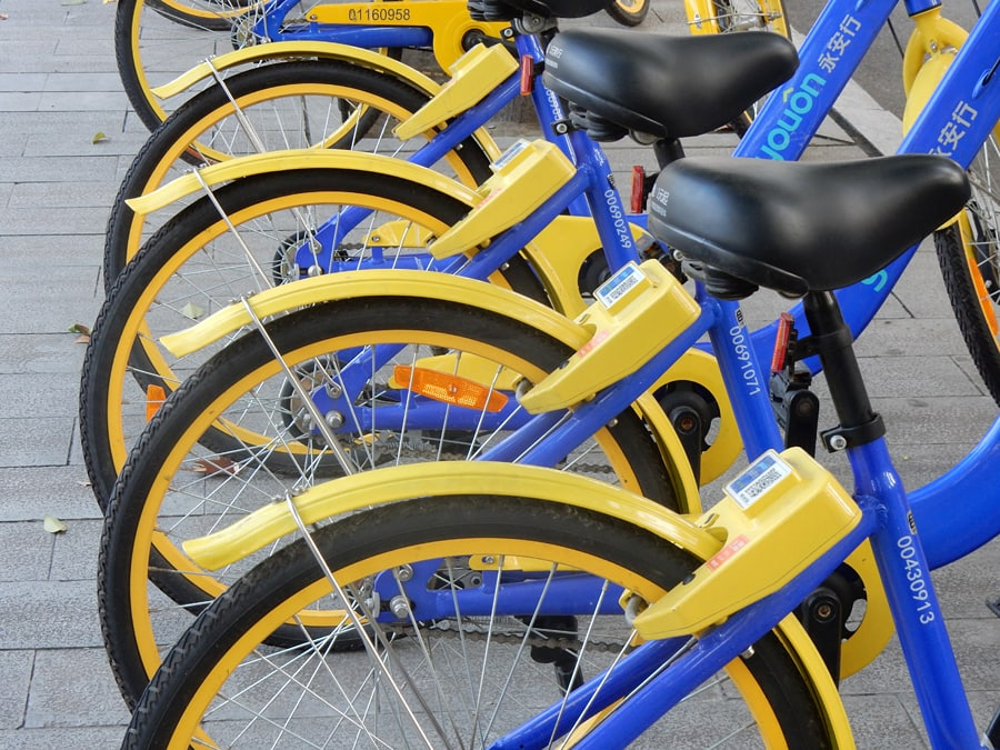 China travel tips | Yellow and blue ebikes lined up in a row
