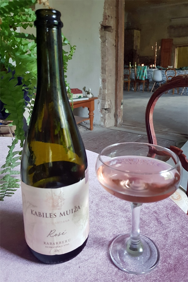 A glass of pale pink rhubabe wine | Tasting Latvian wine at Kabile Manor Winery in western Latvia