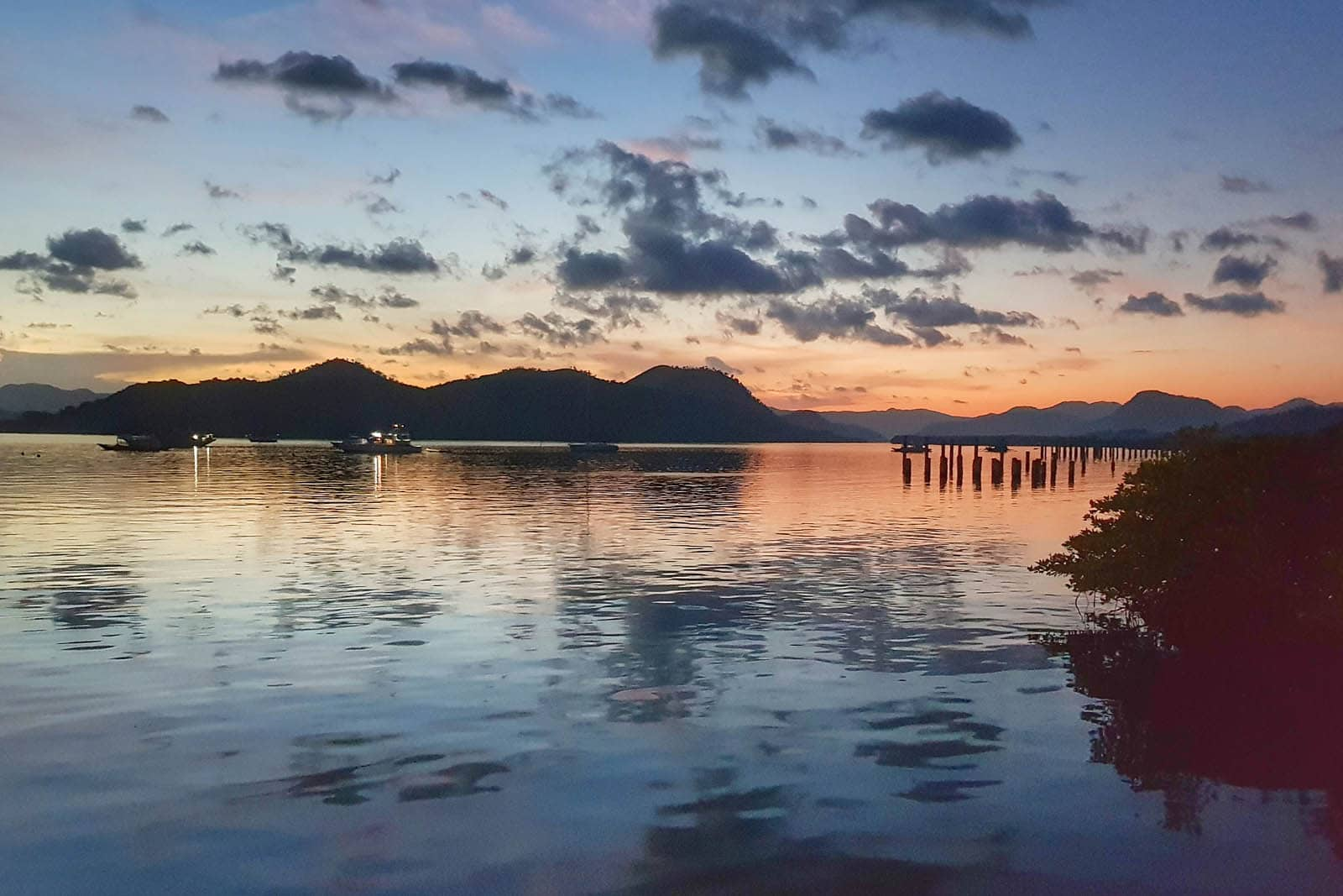 View of the bay at sunset from Bacau Bay Resort, Coron, Philippines