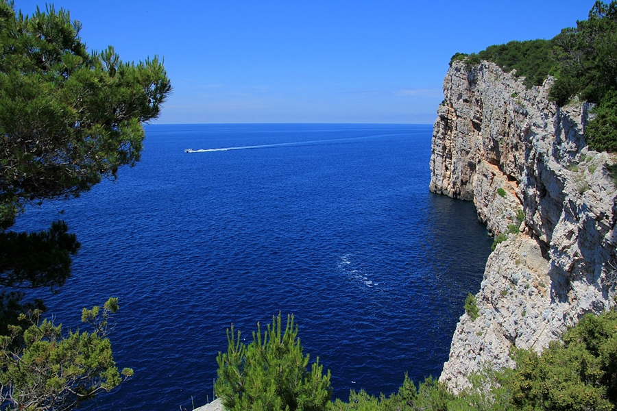Dramatic cliffs pluging into the bluest of seas in Croatia