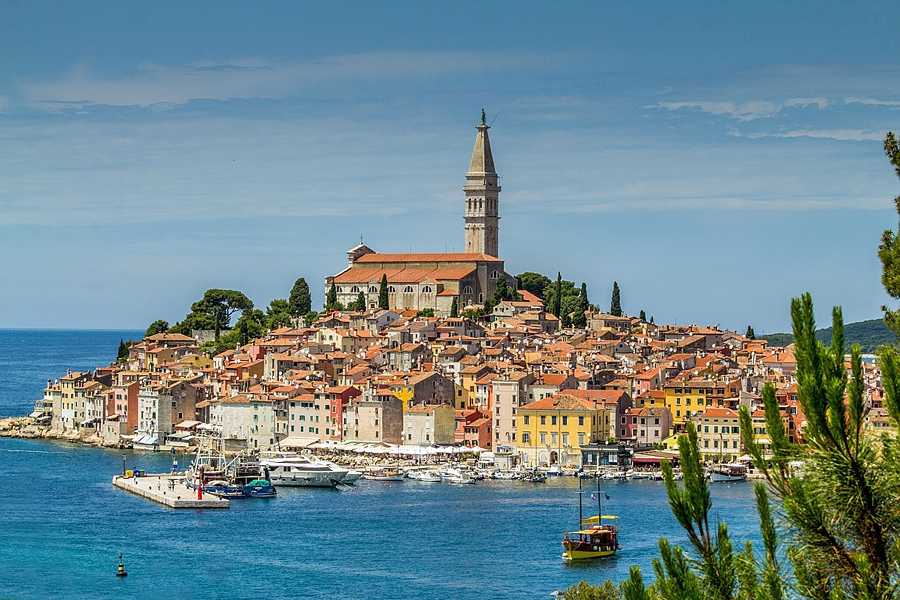 View across the sea to he terracota tiled roofs of Rovinj, Croatia - tourist guide to Croatia