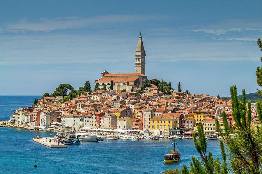 View across the sea to he terracota tiled roofs of Rovinj, Croatia - tourist guide to Croatia