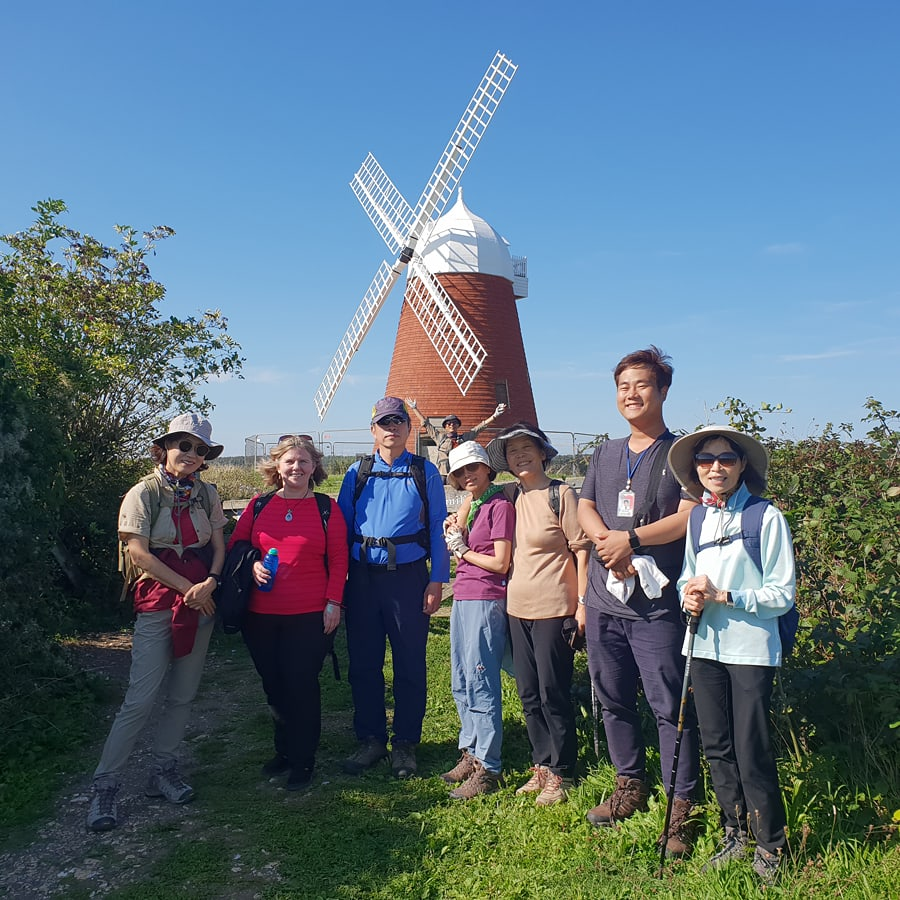 Kathryn and her guests on a guided walk in the South Downs