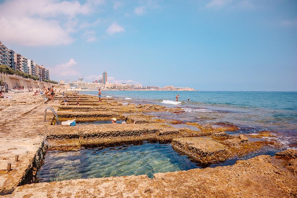 Sqaure pools cut out of the rock forming seawater bathing pools, Roman Baths, Malta